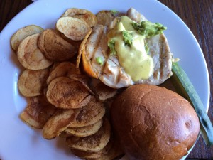 Chicken sandwich with lime aioli and avocado.